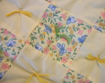 Yellow baby quilt with butterflies and flowers