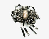 Vintage Hobe Sterling Silver Floral Spray Brooch with Carved Cameo and Ribbon Detail