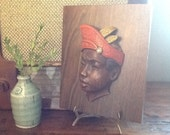 Vintage Mid Century Modern Wall Hanging Of Balinesian Hoy Ceramic Head on Teak Laminate Panel