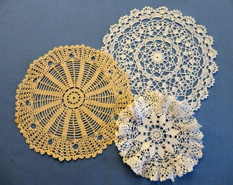 Vintage Doilies - Three hand crochet lace, all round, one rich cream color, two white, 1 with scalloped edge, 1 small with ruffled edge