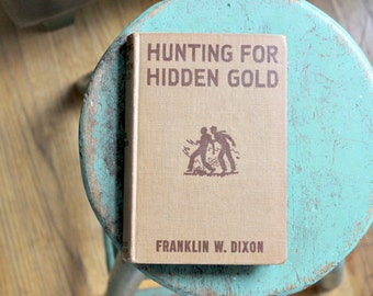 vintage hardy boys book hunting for hidden gold