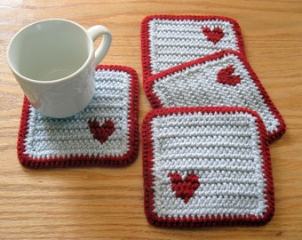Crochet Coasters. Light gray coaster set with small red hearts. Set of 4, crocheted cup coasters