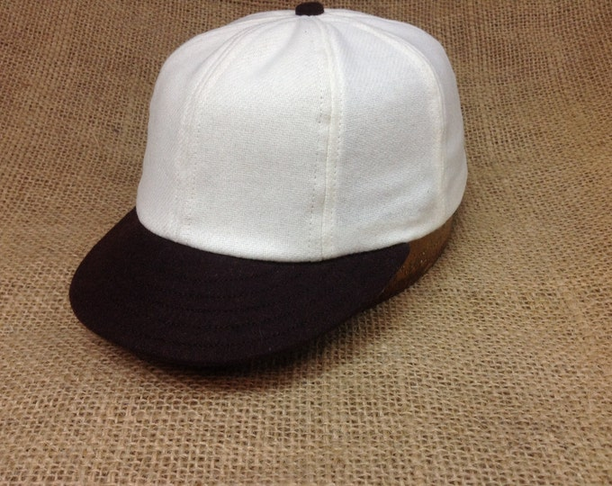 "White wool flannel 8 panel cap, black 2"" visor,  Fitted to any size, cotton sweatband"
