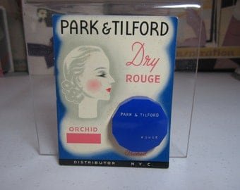 Art deco 1930's-40's Park & Tilford blue plastic rouge container on Art Deco lady  illustrated