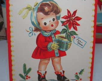 Sweet 1948 colorful Whitman christmas card adorable little girl holds a potted red poinsettia