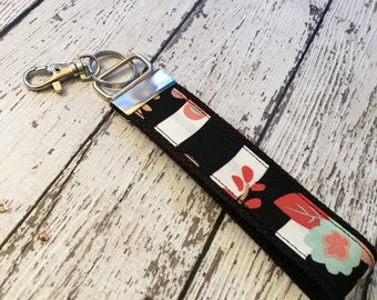 Stripes and floral print key fob wristlet on black cotton webbing with swivel lobster clasp