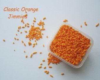 orange jimmies, orange sprinkles