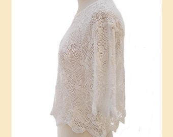 Vintage 1990s top in white crochet lace pattern, cropped style with round neck and half sleeves, UK size 12 to 14