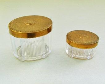 Vintage dresser jar set, pair of c.1930's glass vanity jars with embossed metal lids, Art Deco dresser jars