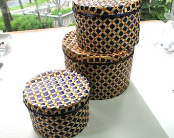 Set of covered bakets, 3 baskets, purple, orange and natural color, nesting baskets