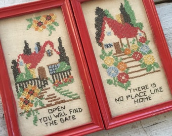 Pair of vintage cottage embroideries, framed, red chippy paint