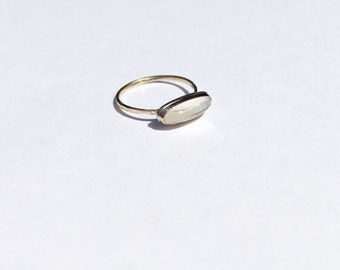 long oval gold and moonstone ring