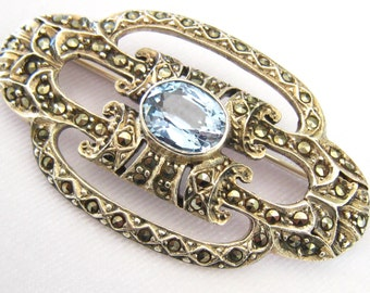"CLEARANCE Sterling & Marcasite Art Deco Vintage brooch with Center Blue Stone.  Marked 925.  Measures 2"" x 1-1/8 "". Weight =13.5 Grams."