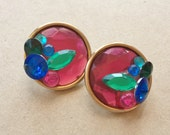 large vintage gold tone pierced earrings with layered 80s jeweltone rhinestones of hot pink green cobalt blue