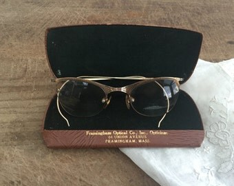 Vintage pair of glasses in a case