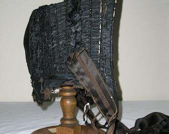 ON SALE 1860s Black silk taffeta gathered bonnet