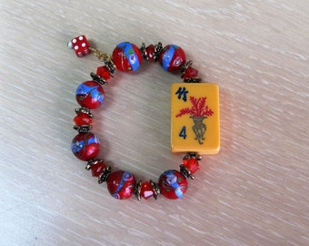 "Mahjong bracelet with vintage ""flower"" tile and dice charm"