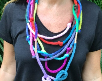 Multicolored multi strand rainbow necklace. Tubular scarf knit w silky merino soft yarn. Fiber textile bright colorful jewelry with knots