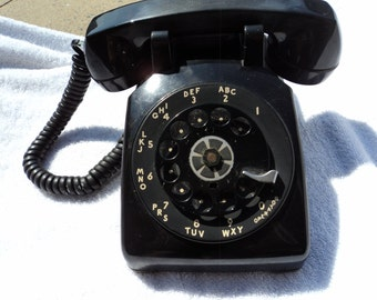 Vintage rotary telephone/ working condition/ready for hook up/black/ shows some wear