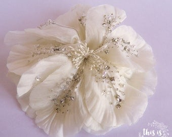 No. 25. Bridal haircomb. Large ivory silk flower with hand sewed rhinestone.