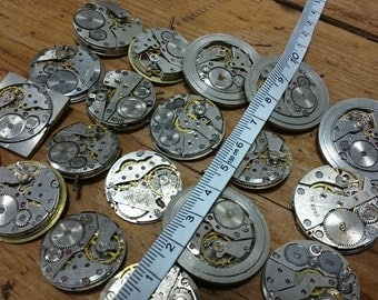 Lot of 20 vintage mechanical watch movements, watch parts mixed media jewelery lot, 1 big movements