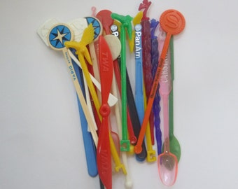 lot of 23 colorful assorted swizzle sticks - travel souvenirs from airlines, hotels, and more! - kitschy addition to your bar
