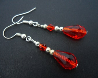 A pair of pretty silver plated red  glass crystal  teardrop bead dangly earrings.
