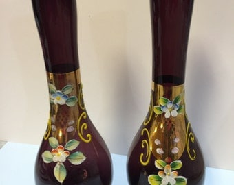 Oriental handpainted plum colored vases.