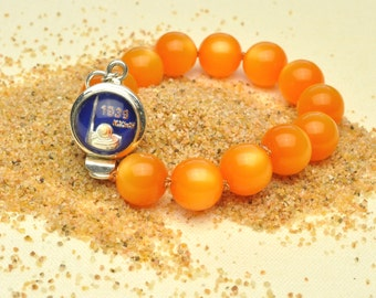 Colorful Tangerine Bracelet Features 1939 New York World's Fair Clasp