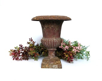 Large Striking French Antique Medici Cast Iron Urn from the 1800s
