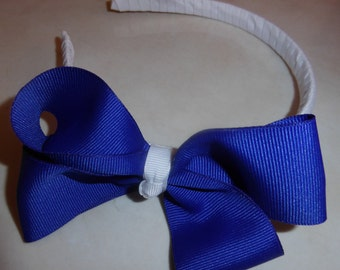 White headband with large royal blue bow for girls