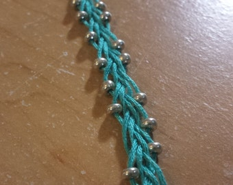 Braided and beaded bracelet