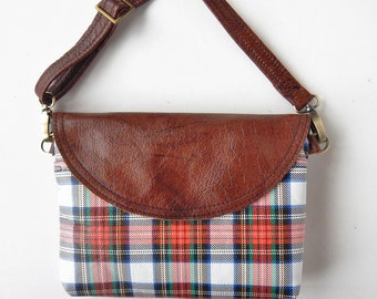 Leather crossbody bag in plaid with brown leather trim.  Sling bag in plaid leather.