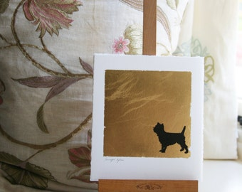 Hand painted Cairn dog pen and ink silhouette on gold leaf on paper.