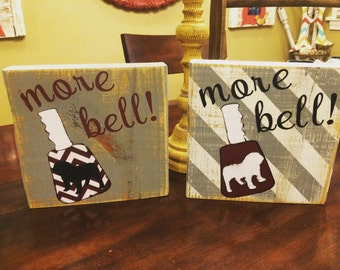 Distressed More bell cowbell sign