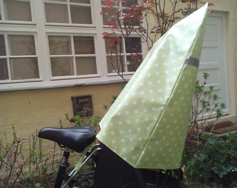 Rain cover for the child bicycle seat - harness - reflector