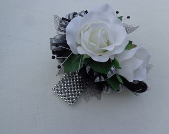 Corsage and matching boutonniere in silver and black