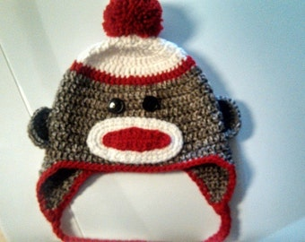 warm handmade crochet sock monkey hat with earflaps and braids for kids free shipping