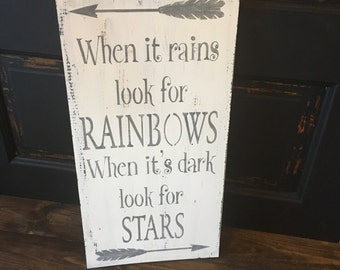 When it rains look for rainbows, inspirational sign