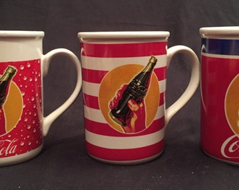 Coca Cola tall ceramic mugs