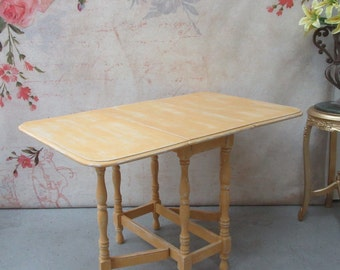 Drop Leaf Yellow Table
