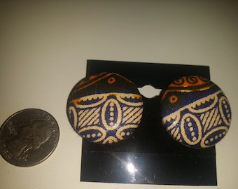 African fabric button earrings in blue and orange.