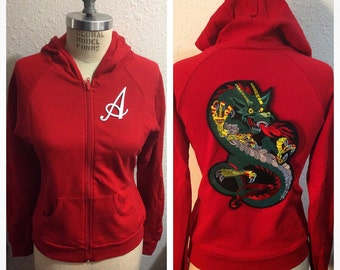 Slim fit american apparel hoodie. Customizable embroidered  front letter. Dragon embroidered back patch.