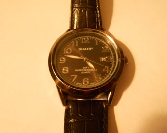 large sharp mens watch with date