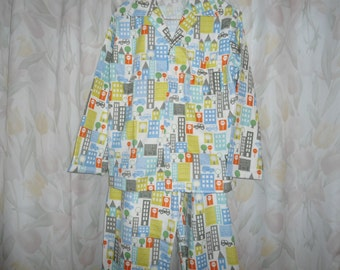 Boys Size 14 Pajamas with cars and buildings on white back ground.