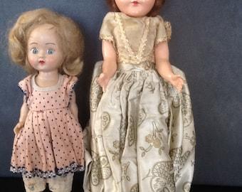 2 plastic vintgae dolls with oriinal clothing