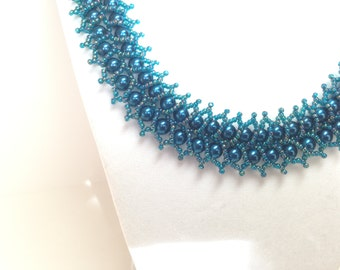 Teal double row pearl necklace.