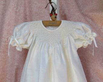 Smocked white silk dress