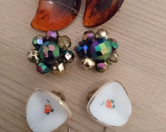 four pairs of vintage earrings