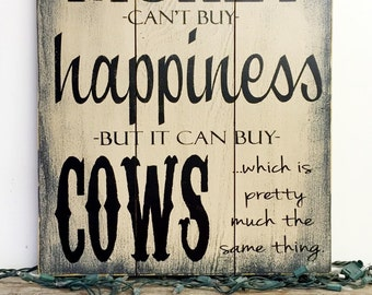 Money Can't Buy Happiness, But it Can Buy Cows